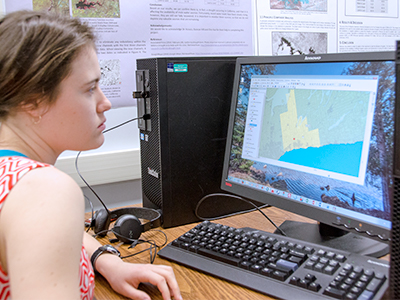 student on a computer in the geomatics lab