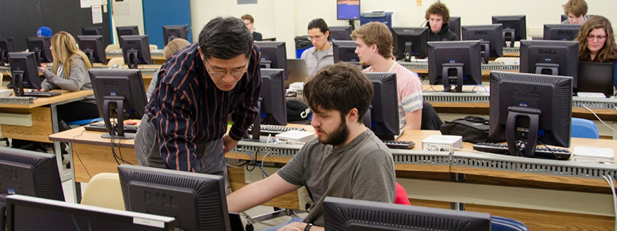 students and professor in a computer lab