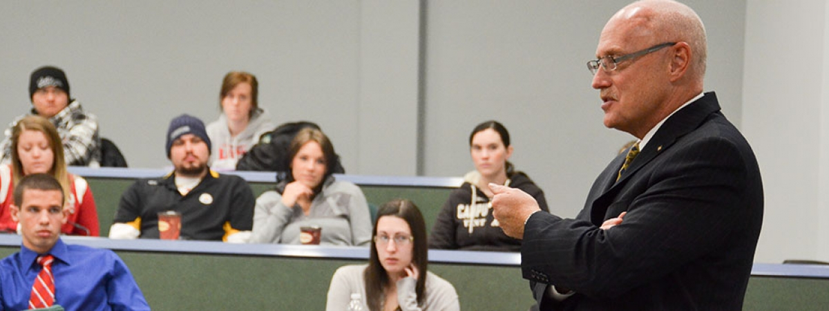 Former O.P.P. Commissioner Chris Lewis talks with Criminal Justice students