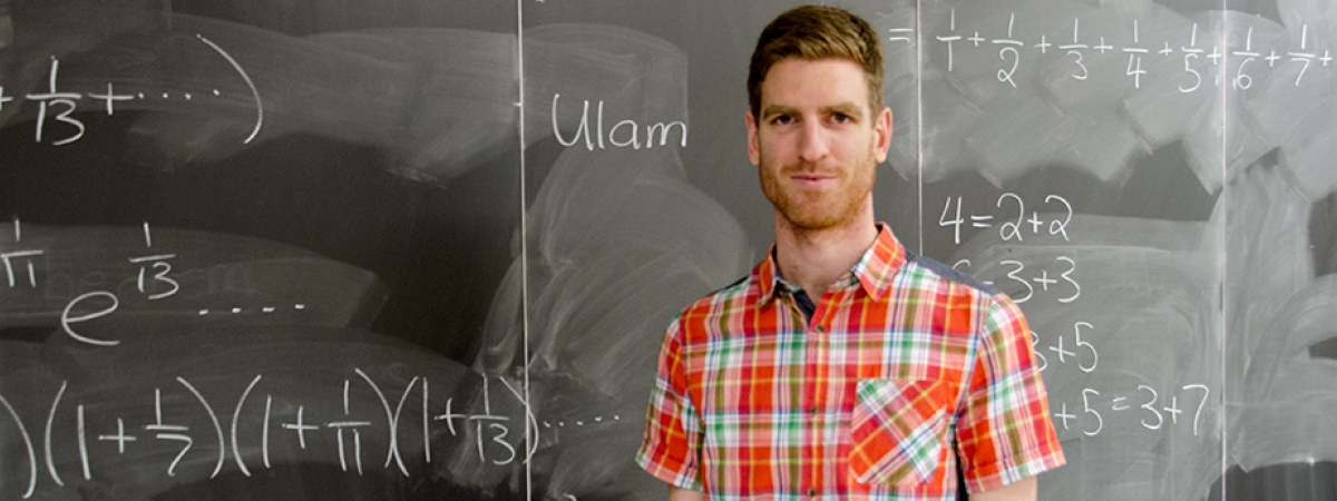 professor in front of chalkboard