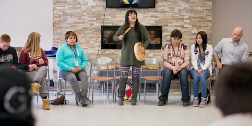 Wiidooktaadwin Year end conference, students participate in Hand drum teachings and songs ​